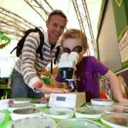 Dad Andd Daughter | Looking Through A Microscope | Science